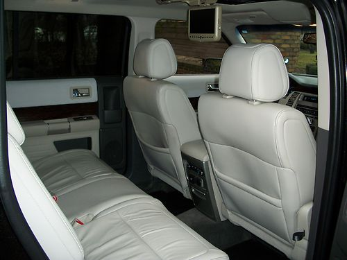Inside The Flex Offers A Basic Ford Interior Some Hideous And Easy To Stain White Leather In This Example Seats That Are Un Supportive But Comfortable