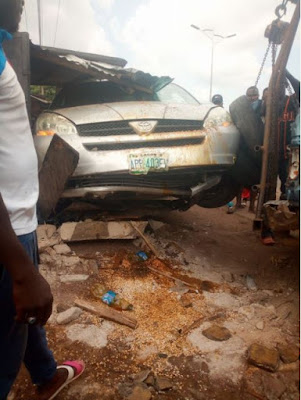 Lady Cheats Death As Speeding Vehicle Rams Into Her Shop