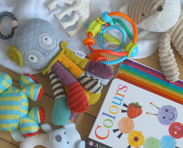 various baby toys and books flat lay