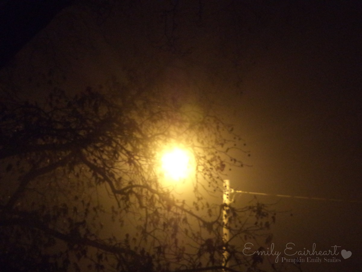 A light surrounded by fog at night.