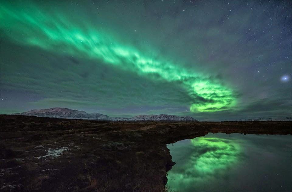 Aurora Borealis behind clouds, Iceland