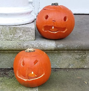 Picture of two Halloween pumpkins on our doorstep