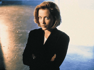 Gillian Anderson as Dana Scully