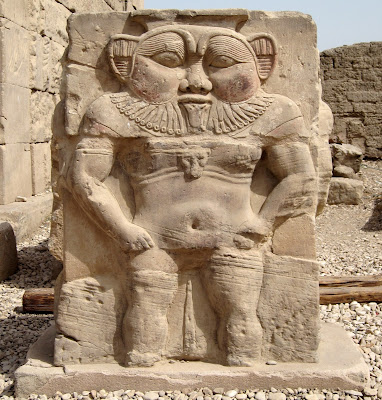 he dwarf deity Bes depicted below a cornice in the Denderah Temple complex