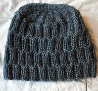 http://www.ravelry.com/patterns/library/the-colosseum---the-hat