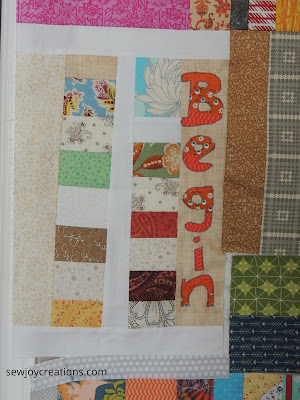 machine stitched word on quilt