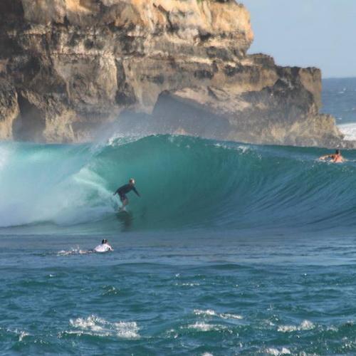 Tinuku Travel Watu Karung beach in Pacitan gave two spots rip curl surf big waves and barrel left-right between rock walls
