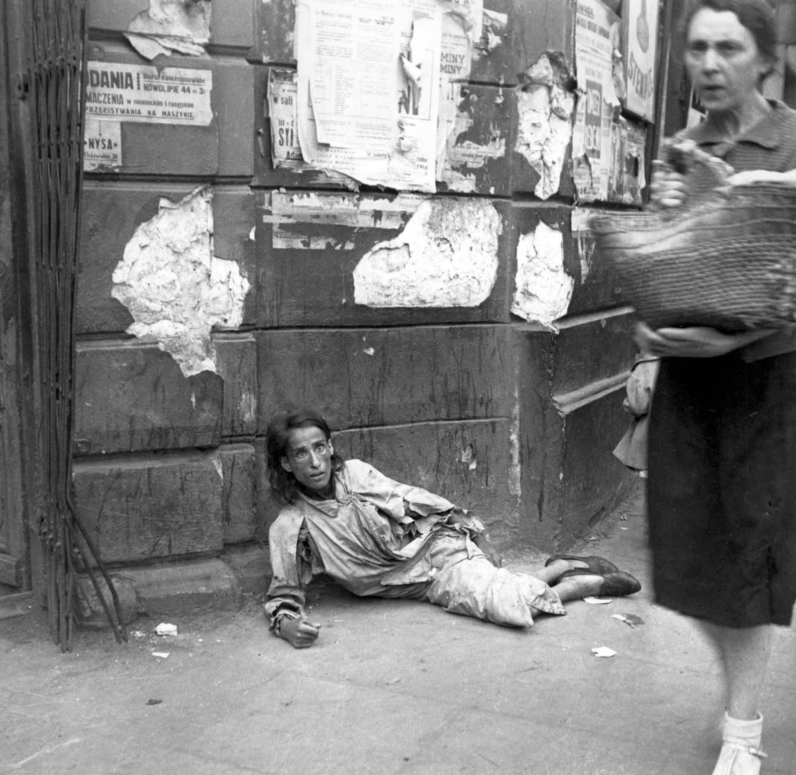 A woman lying on the pavement in the Warsaw ghetto, starving to death, 1941. (Photo taken by Heinz Joest).