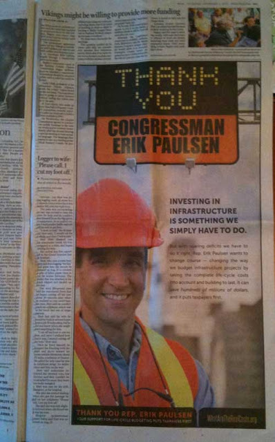 Ad with white guy in an orange hard hat and highway sign that reads THANK YOU Congressman Erik Paulsen