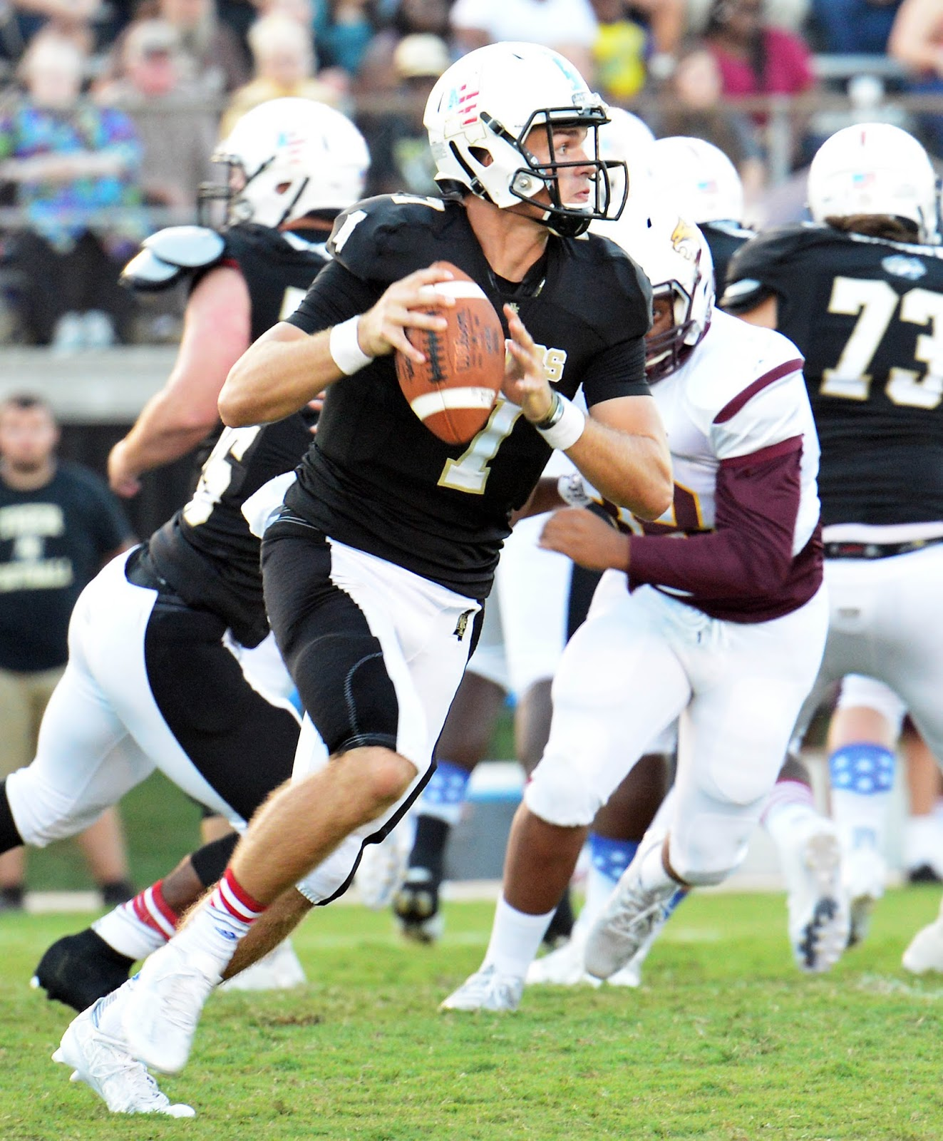 ne fb nemccvspearlriver5 northeast mississippi community college quarterback mason cunningham 7 looks for an open receiver during action in the first