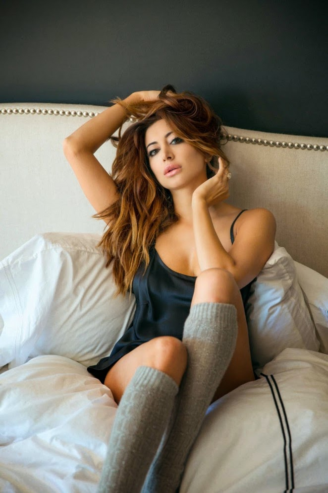 Noureen DeWulf goes sultry for a photoshoot for Playboy Magazine January/February 2015