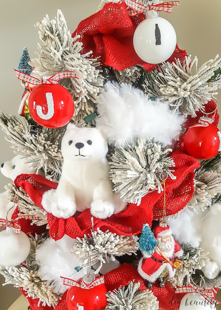 Transform a tabletop Christmas tree with a Coca Cola theme. You can find out how I decorated this adorable tree at diy beautify!