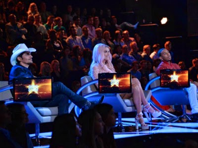 "Brad Paisley, Kesha and Ludacris doiing their best to look like they are excited to be a part of ABC's ""Rising Star."""