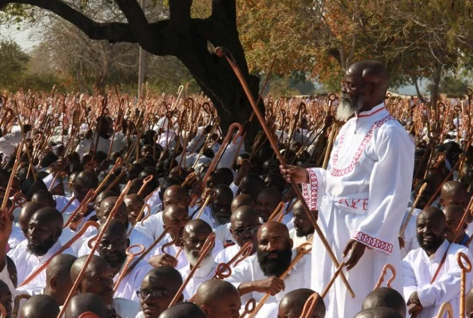 St Noah Taguta leads members of the Johane Marange Apostolic Sect in song during a Passover Conference at Mafararikwa July 2015