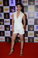 Actress Gauhar Khan  Pictures in White Shorts at Mirchi Music Awards 2016  0004.jpg