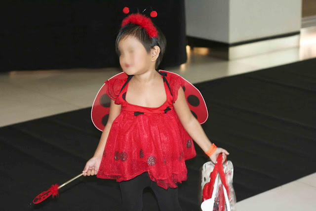 Girl wearing a lady bug costume