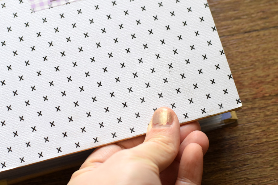 using scrapbook paper to cover an album