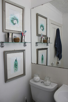 Adding two peacock prints to the bathroom