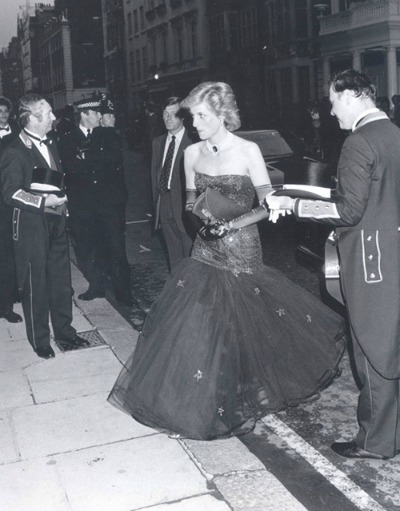 The late Princess Diana arriving at Claridges Hotel in 1992.  She is wearing midnight blue Cornelia James' Hermione  gloves  and a Bruce Oldfield evening dress.