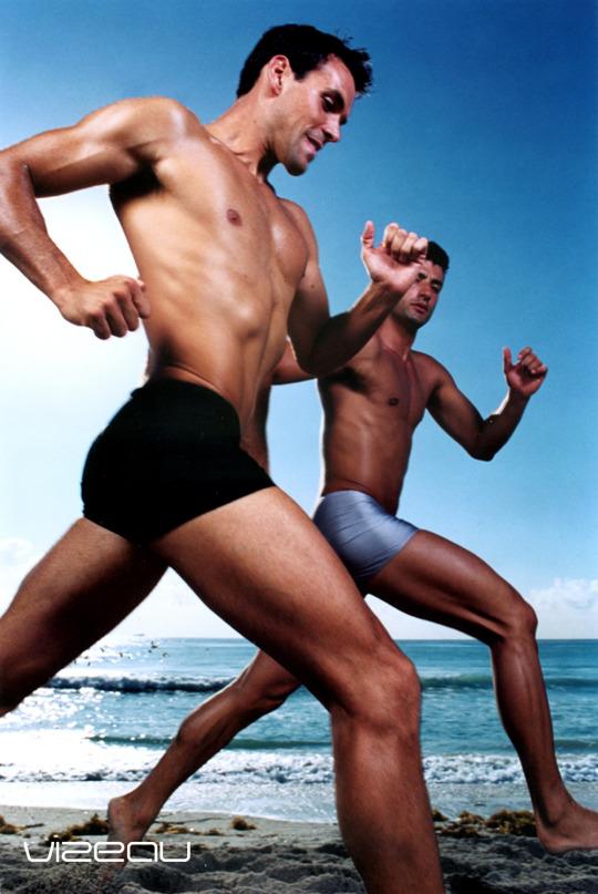 male models Francois and Fabrizio running in Vizeau swim shorts