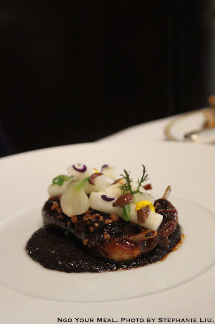 Grilled and Glazed Pigeon, Truffle, Olive, Steamed Turnips, and Onions at Le Cinq