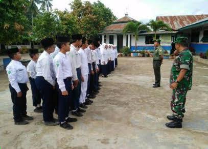 Dalam Rangka MTQ ke 46 Kabupaten Labuhan Batu, Serka Dedi Herman Laksanakan Pelatihan Paskibraka
