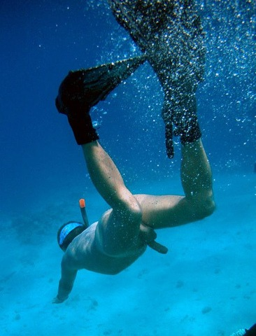boys scuba diving naked