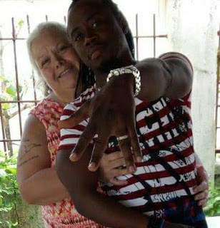 Awww... true love! Young Sierra Leonean singer and his older white wife are missing each other... like crazy