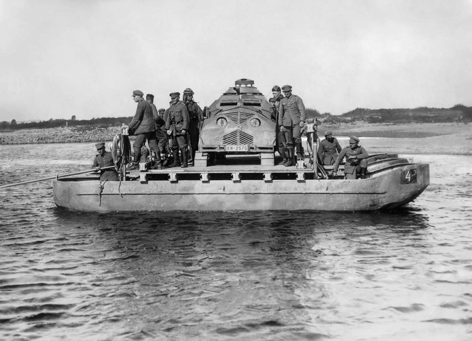 German troops ferry a dummy tank across the river Oder during military exercises. 1932.