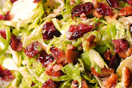 HONEY MUSTARD BRUSSELS SPROUT SALAD WITH CRANBERRIES AND PECANS