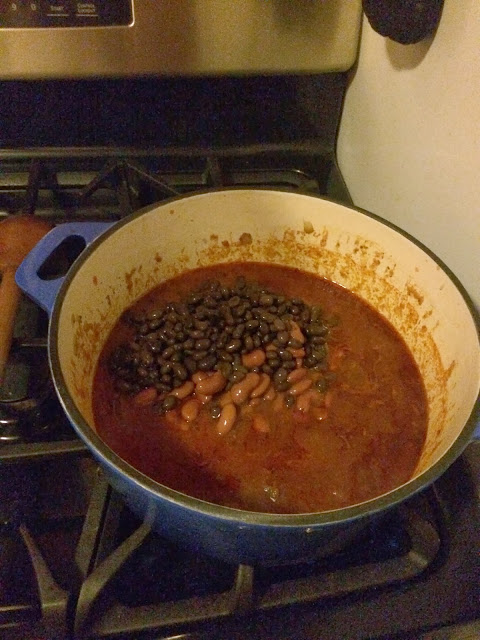 Beans being added to the pot.