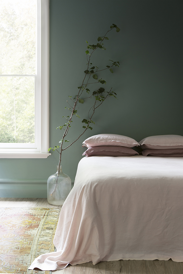 A Dark Green Bedrooms with Accent Wall
