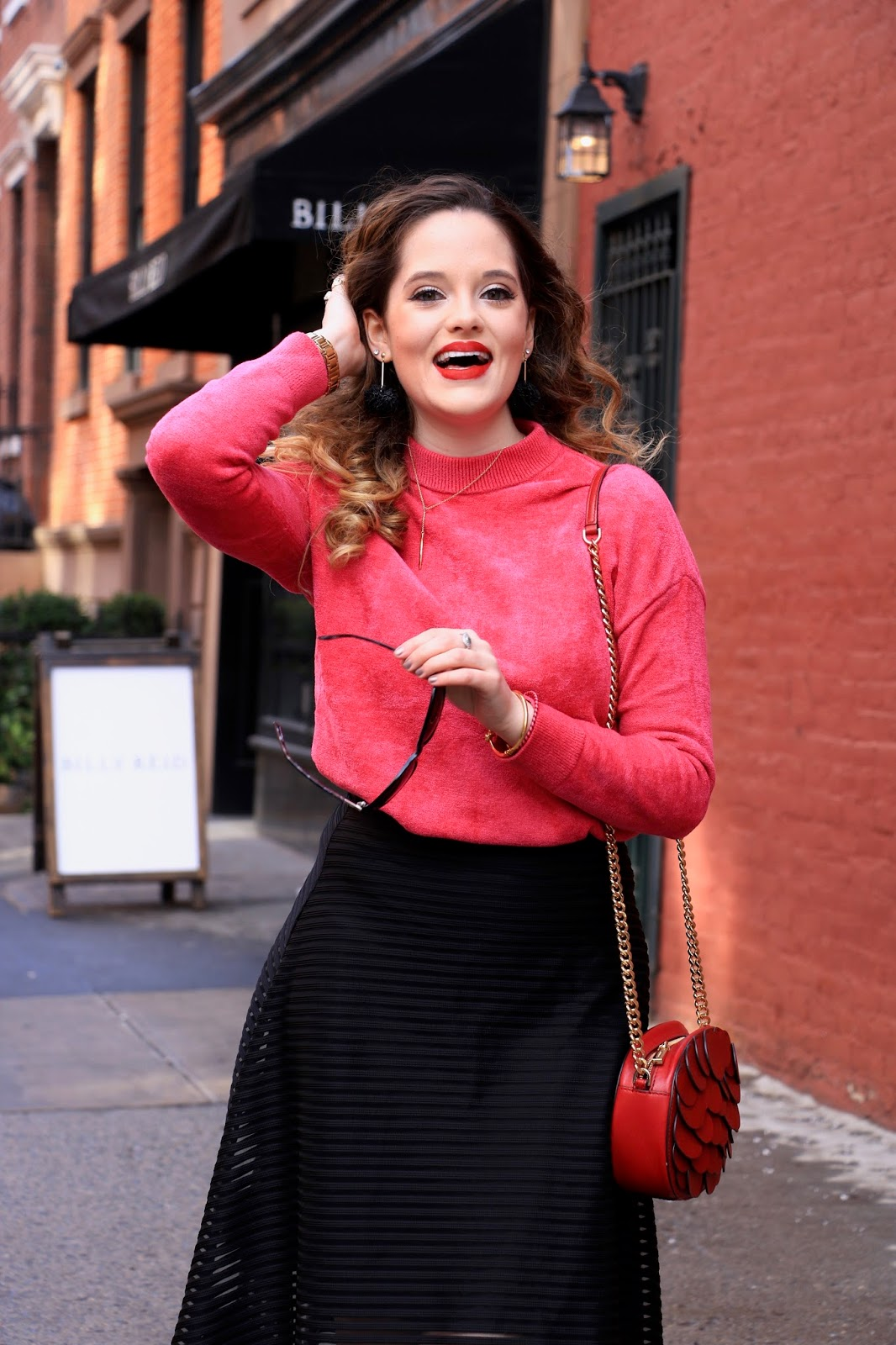 Nyc fashion blogger Kathleen Harper wearing a pink fuzzy sweater