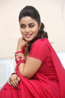Actress Poorna Latest Stills in Red Dress at Rakshasi First Look Launch  0257.JPG