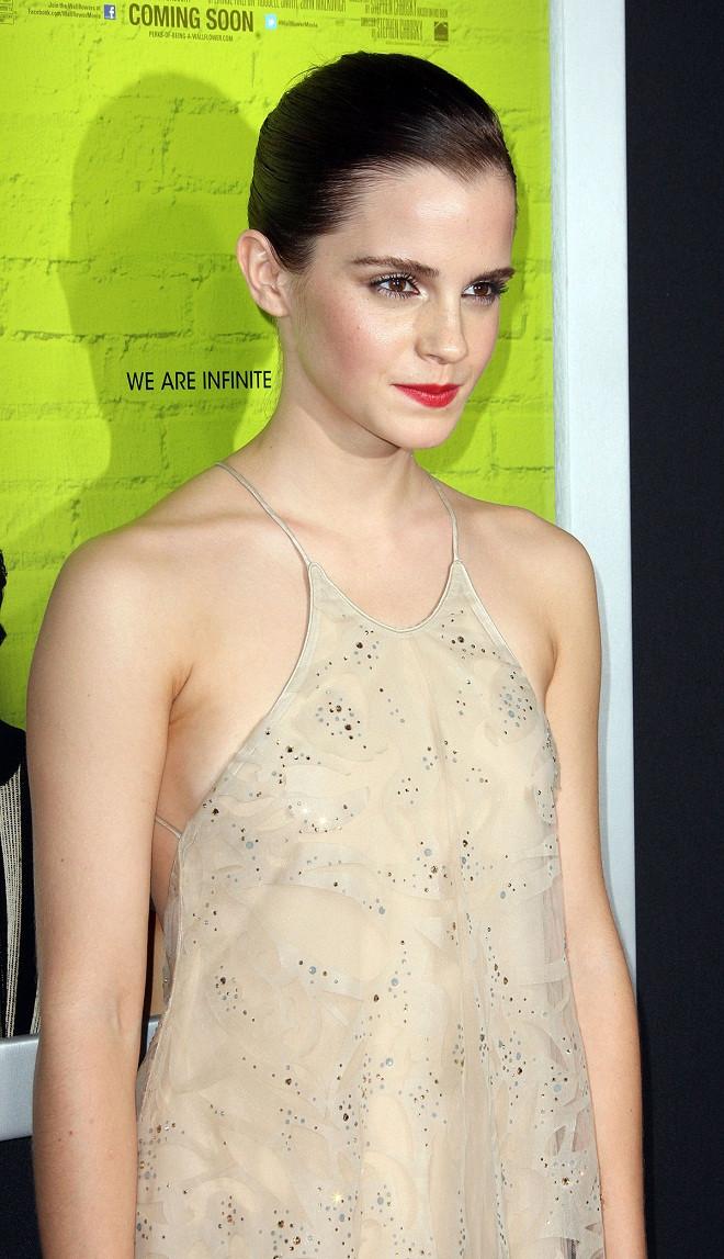 emma watson reveals a bit too much in backless dress at