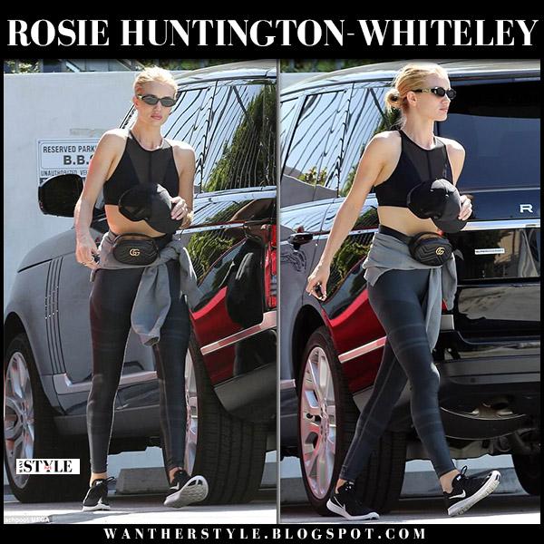 Rosie Huntington-Whiteley in black sports bra, leggings and sneakers street style june 11