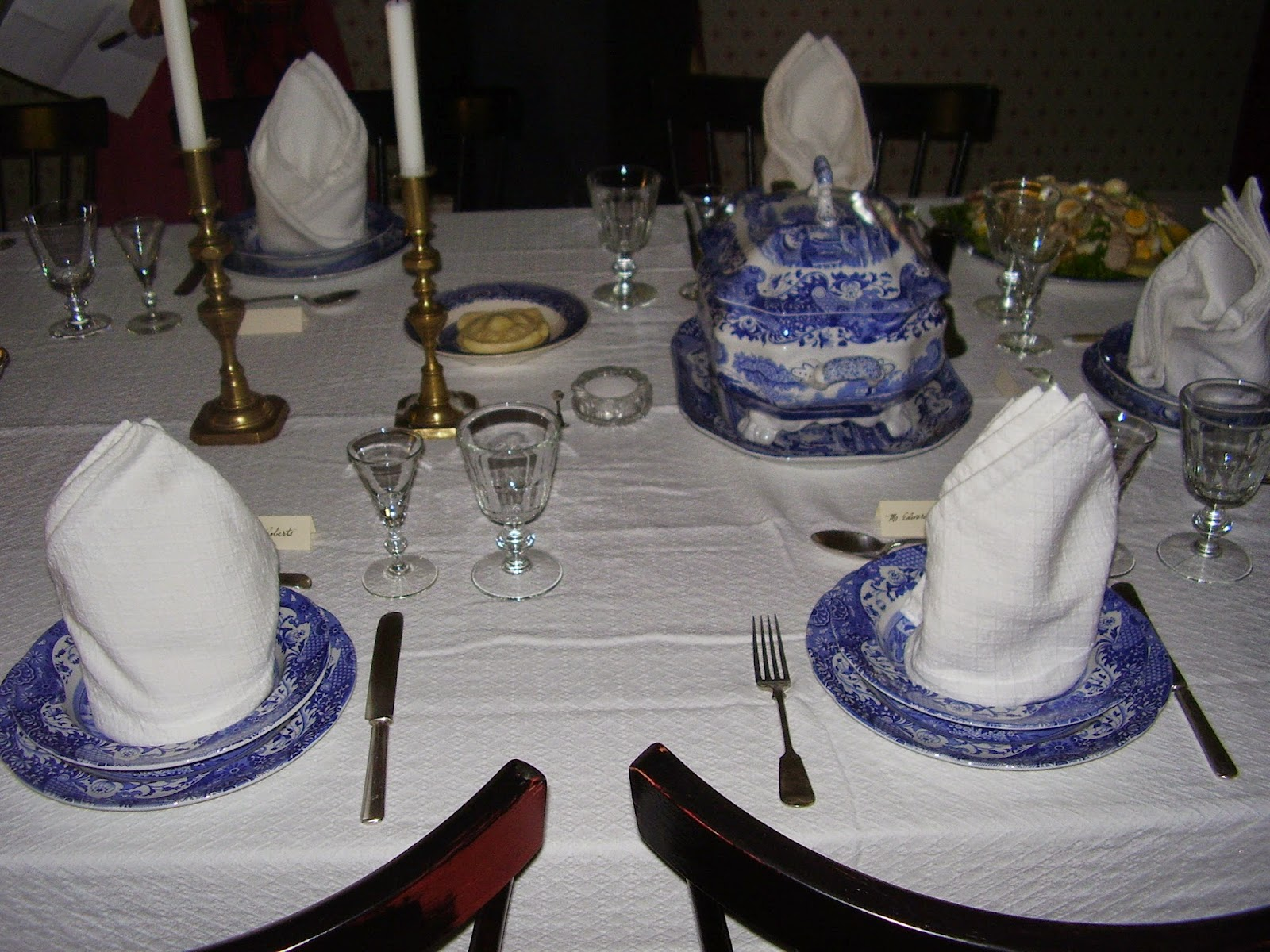Blue Italian place settings and soup tureen; candlesticks.
