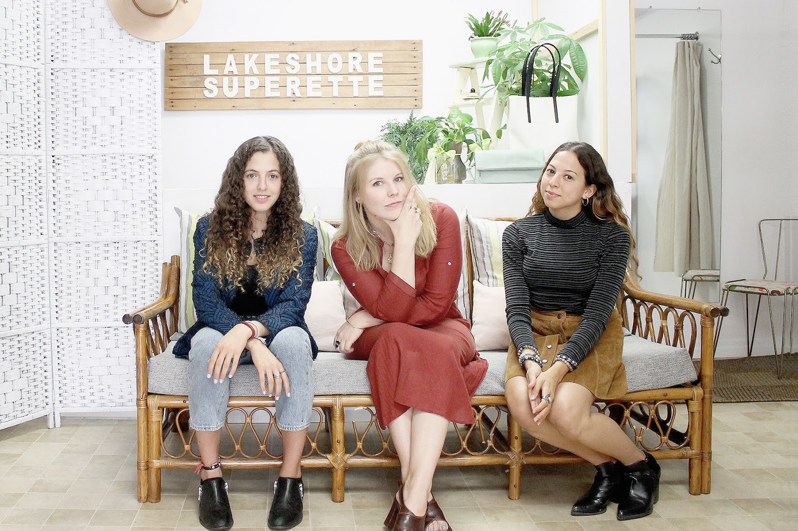Lakeshore Superette in Mississauga. Jude, Yara and Teagen sitting in front of a self-timer