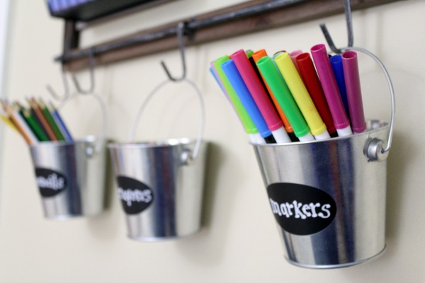 Organized art station for kid's art and craft supplies: Hang metal buckets for easy art supply storage