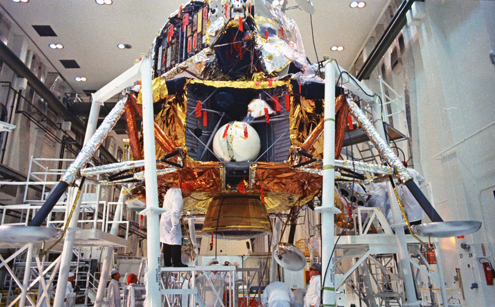 The final checkout of the Apollo 11 lunar module takes place on April 11, 1969, in the Open Bay Area of the Manned Spacecraft Operations Building at Kennedy Space Center.