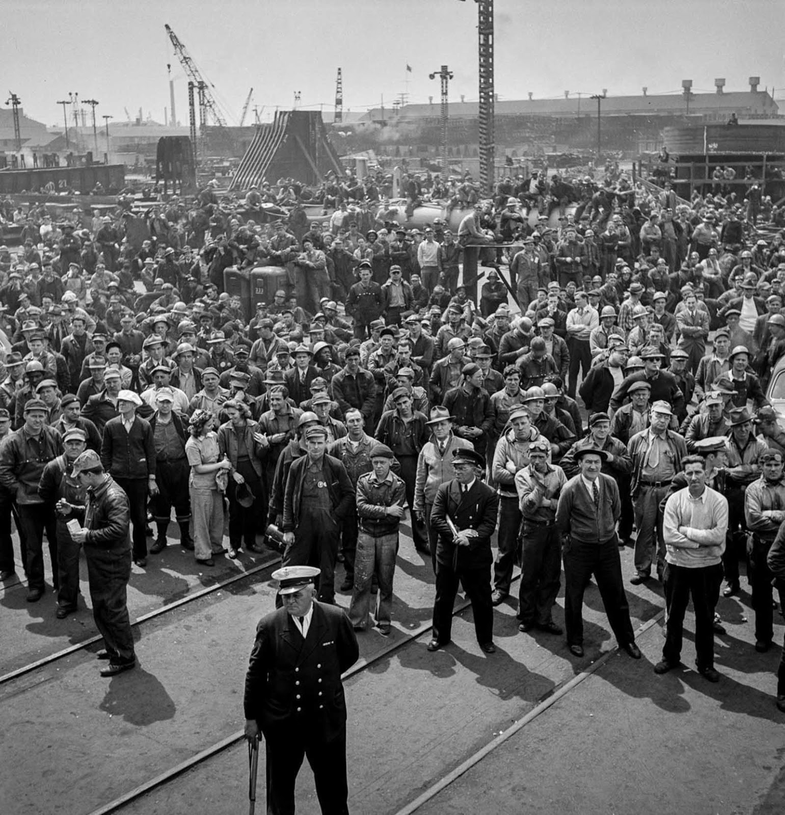 Workers gather for a ship launching ceremony.