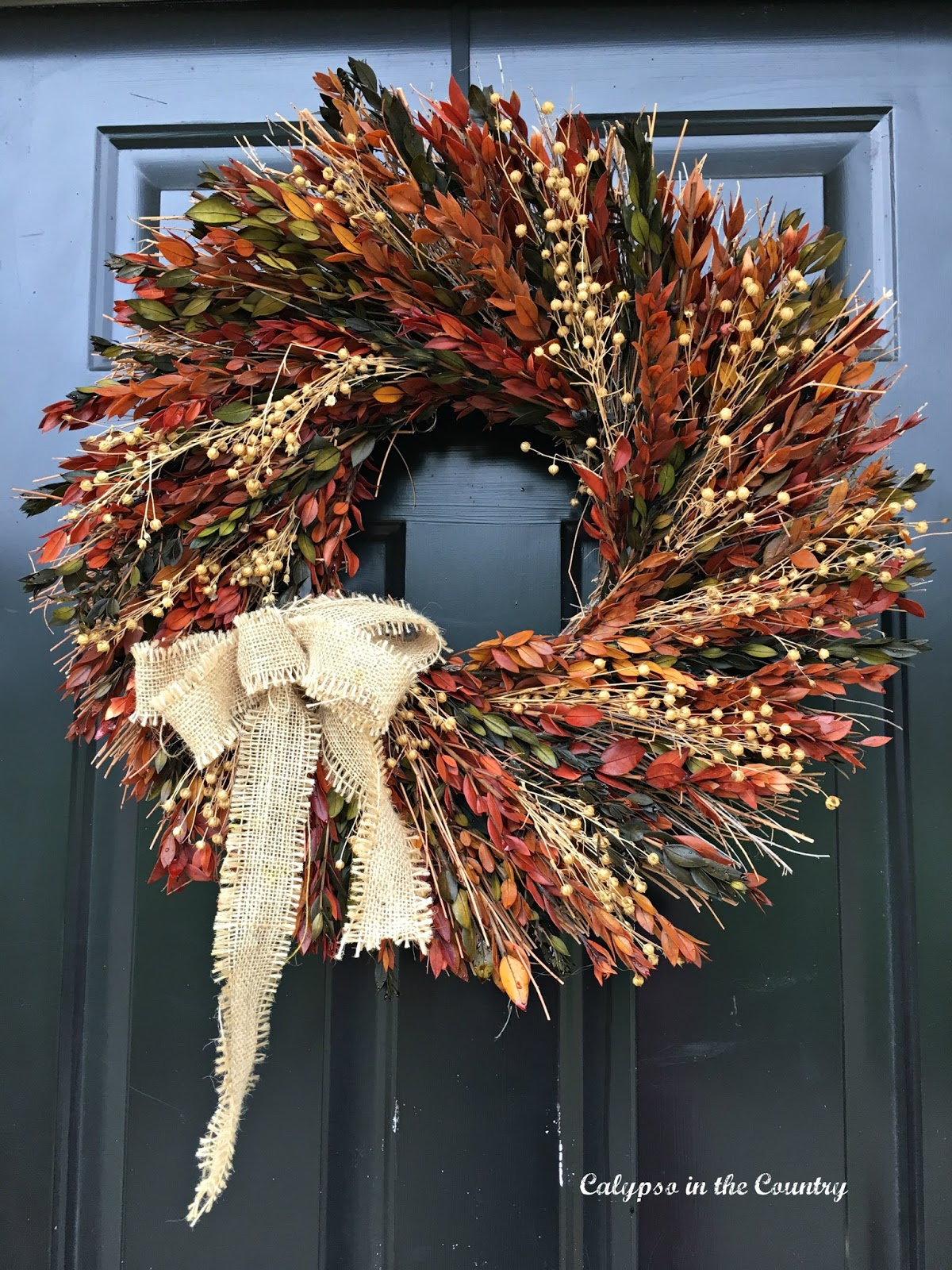 Dried wreath on front door - you might want to think about where you hang this type of wreath!