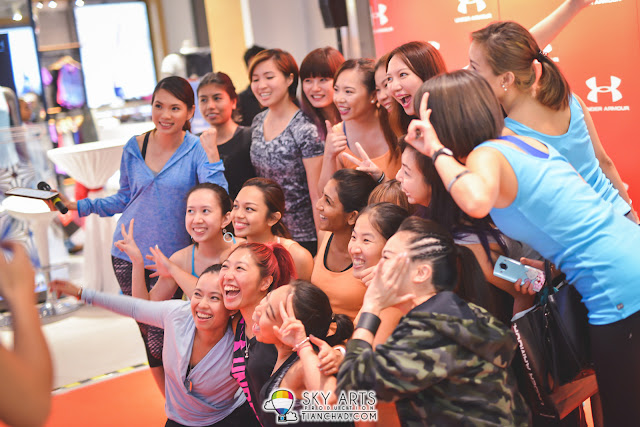 Group photo of the Yoga Session participants at Under Armour Pavilion KL