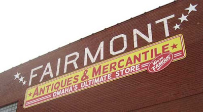 Sign reading Fairmont Antiques & Mercantile, Omaha's Ultimate Store - We're Famous