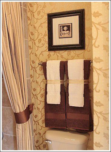 12 ideas decorativas para poner las toallas en el ba o for Accesorios para poner toallas en el bano