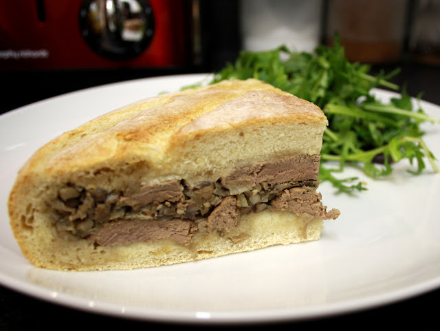 Shooter's Sandwich - steak, mushrooms and mustard all tightly packed into a whole loaf then pressed to create this delicious sandwich