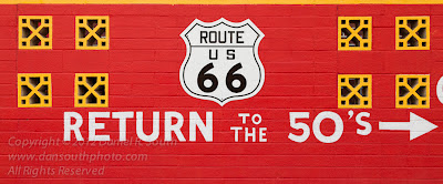 a photograph of a sign on route 66 return to the fifties