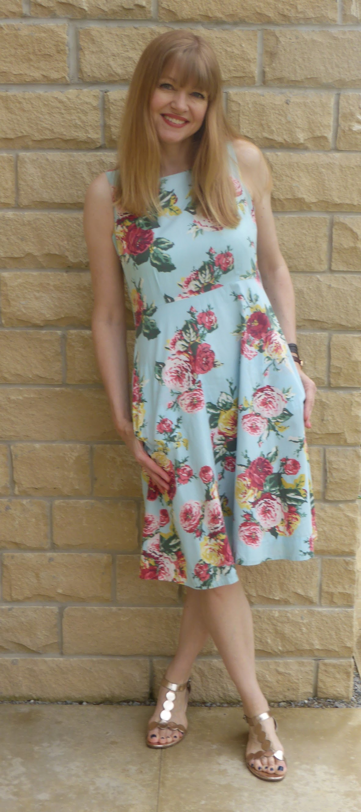 Over 40s blogger What Lizzy Loves wearing multi coloured rose print summer dress with Boden rose gold sandals