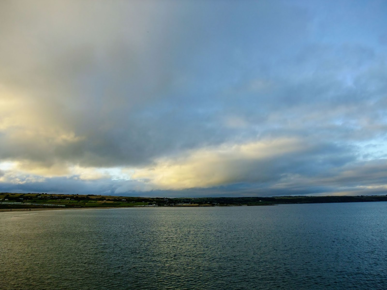 Sunset clouds over water in Ardmore, Co.Cork.