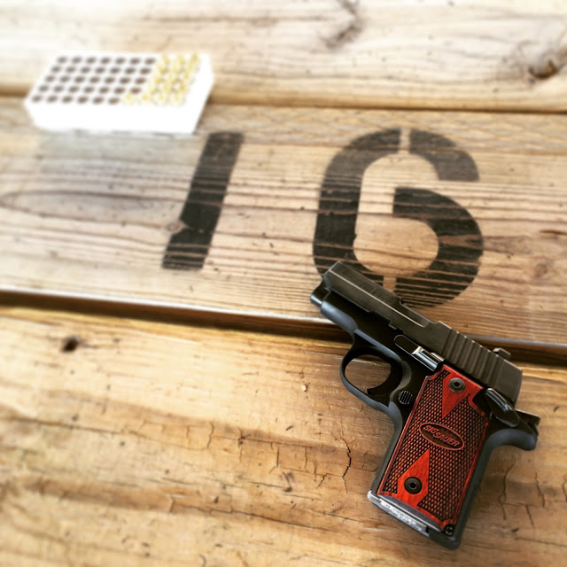 Caroline's Cues | Worth a shot at Heartland Shooting Park - Sig Sauer P238